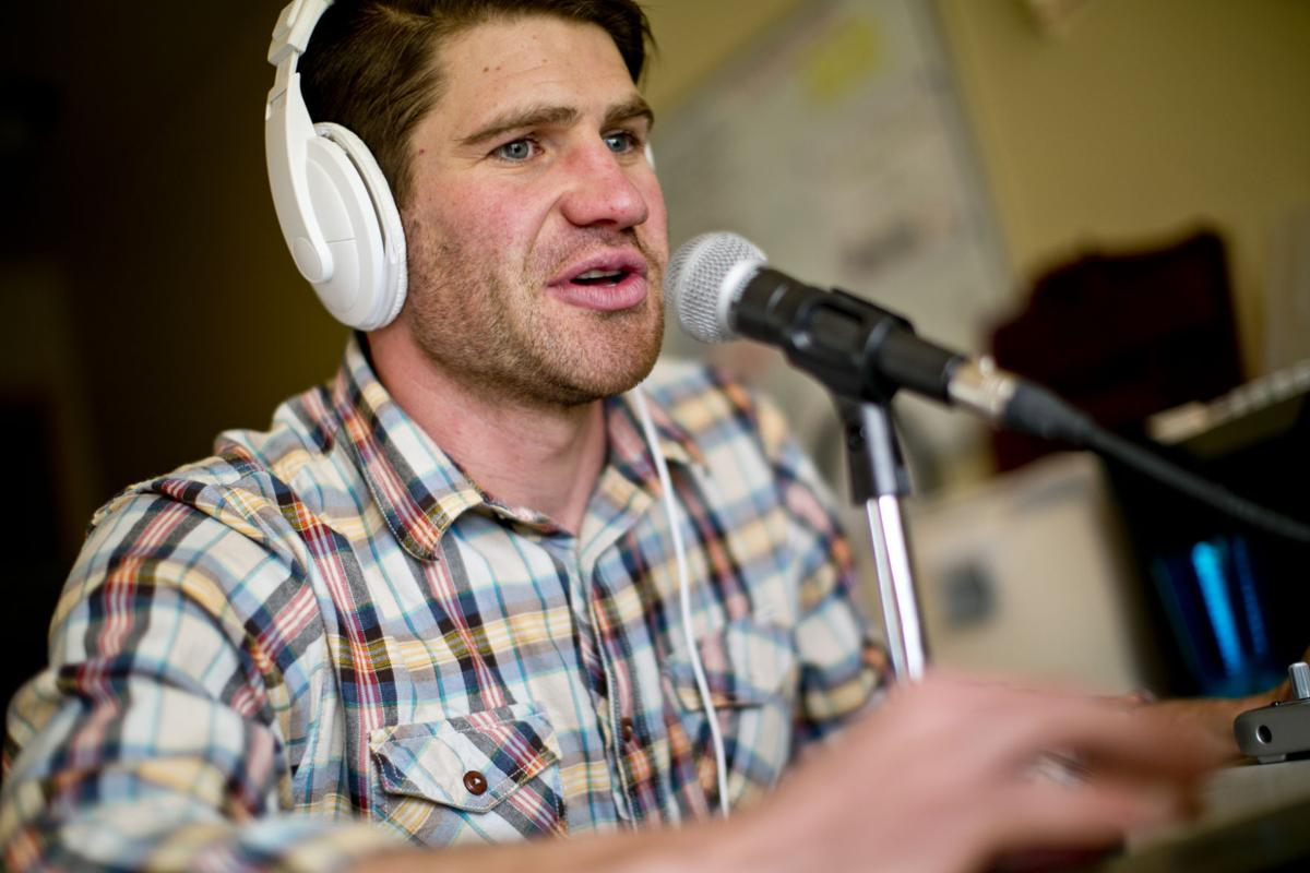 Paul Churchill '05 behind the microphone as he records his 'Recovery Elevator' podcast.