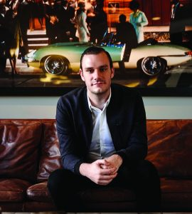 cooper hefner sitting on couch