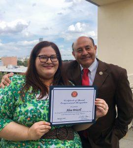 Alisa Driscoll (M.A. '19) with Congressman Lou Correa