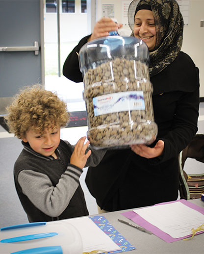 parent and child with change in bottle for math night