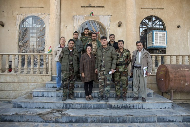 Kelly Galindo with Kurdish soldiers who provided security during her filming in Iraq. (Photo courtesy of Alberto De Coste Calla)