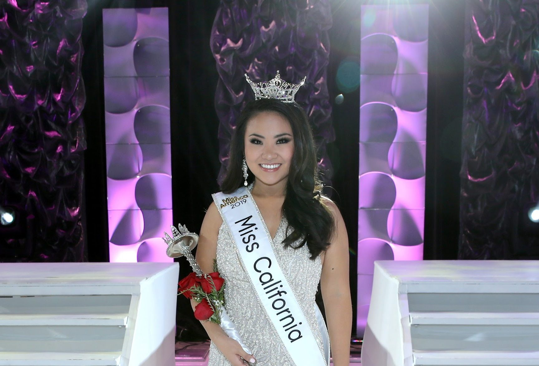 Eileen Ki in white evening gown with Miss California crown, sash and scepter