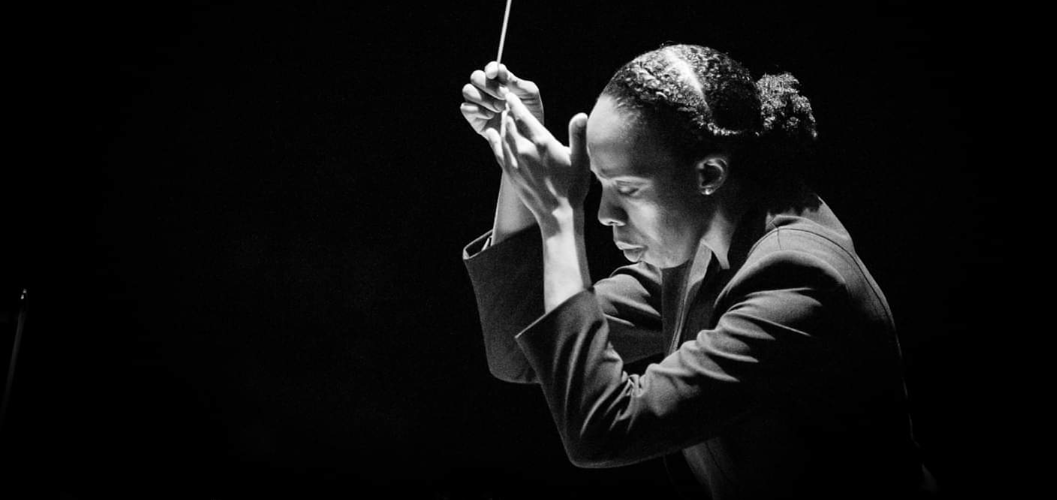 Close up of African American woman conducting orchestra