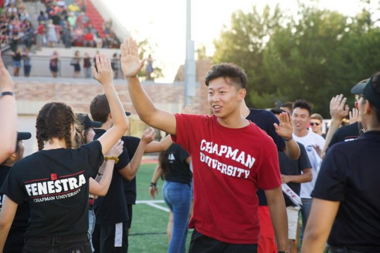 First-year Chapman University student high five