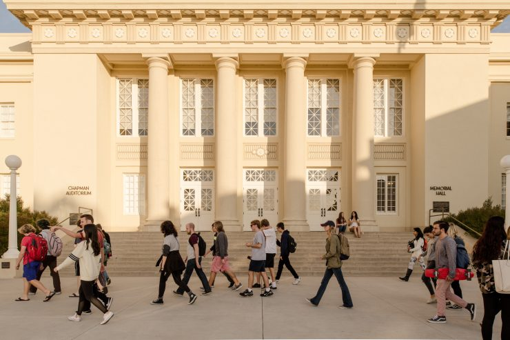 Memorial Hall at Chapman University with students walking to classes
