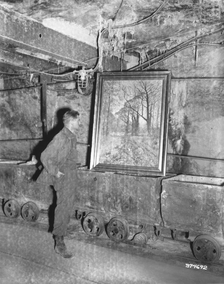 Soldier standing in front of looted painting