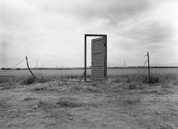 Photograph of door placed on the U.S.-Mexican border.