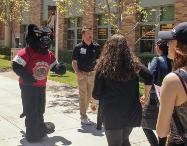 Pete the Panther greets students at Discover Chapman Day
