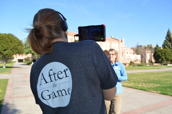 Woman with After the Game Tshirt filming