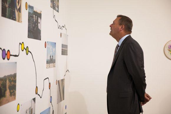 Man observes artwork.