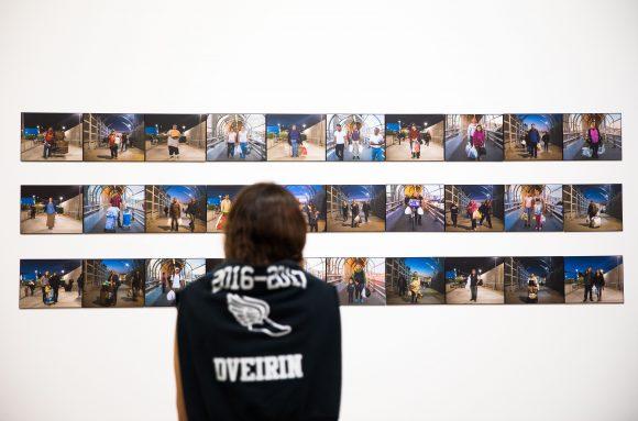 Woman gazes at photographs.