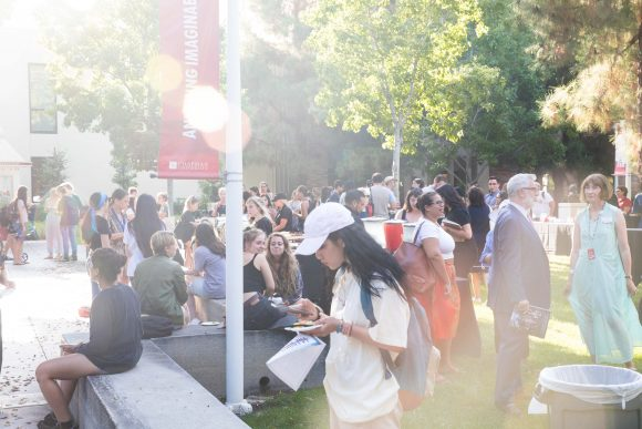 People gather outside on a sunlight afternoon on Chapman's campus.