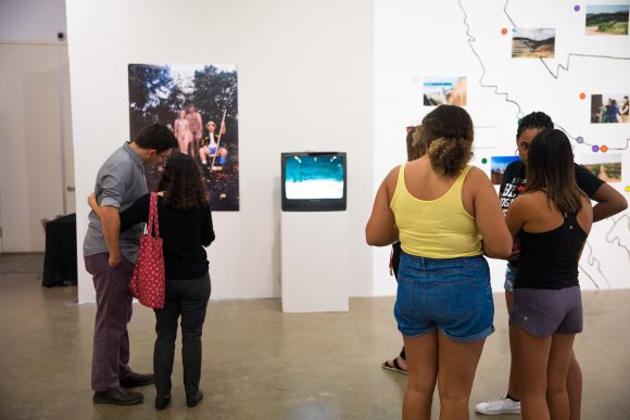 Visitors observe the gallery.