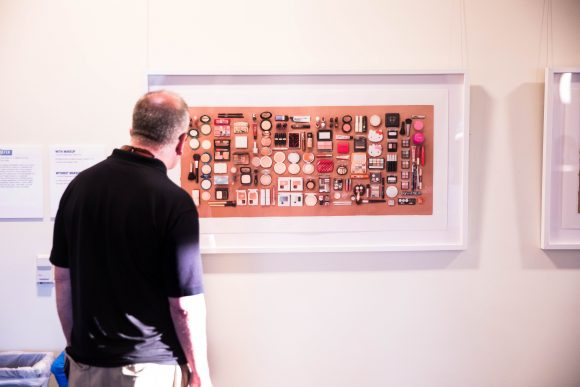 A man looks at a photograph.