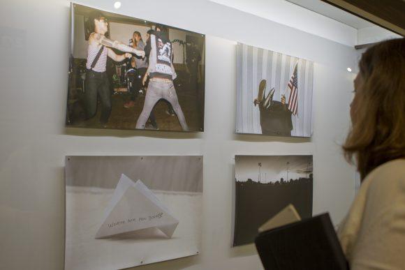 A staff member looks at art.