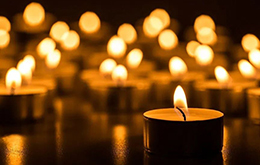 candles burn in darkness.