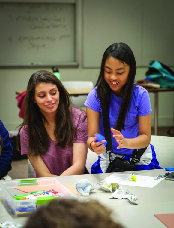 An art project becomes an opportunity for supportive conversation between Chapman student Kate Churukian '19 and her mentee, Amelie.