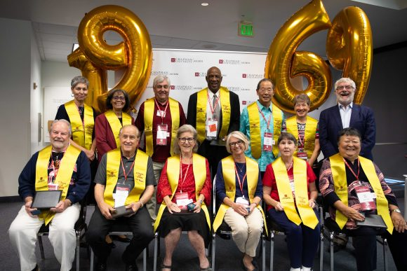 Group shot of the class of 1969 in stoles with balloons