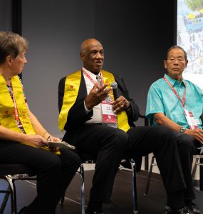 Karen Wilkinson, Frank Franklin, Cliff Ishigaka seated on stage