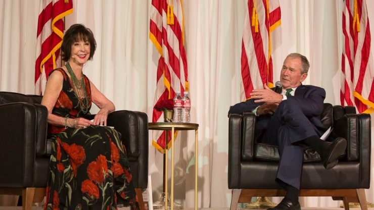 Julianne Argyros and former President Bush enjoy a light moment during their Q&A dialogue at the Argyros School celebration dinner.
