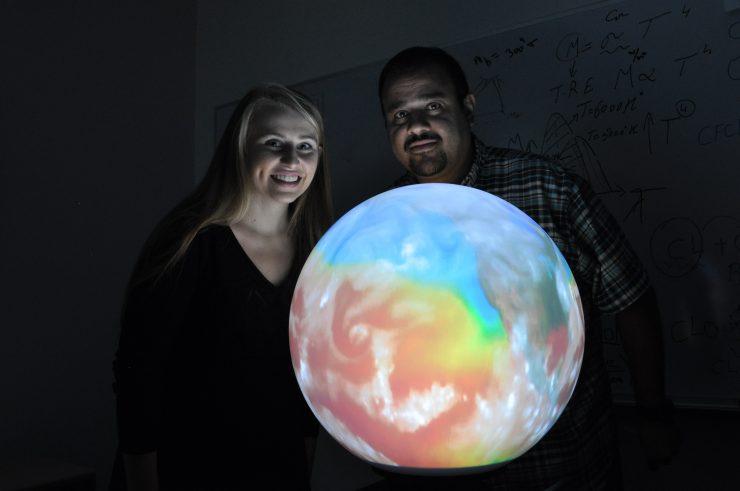 Krista and Hesham with globe