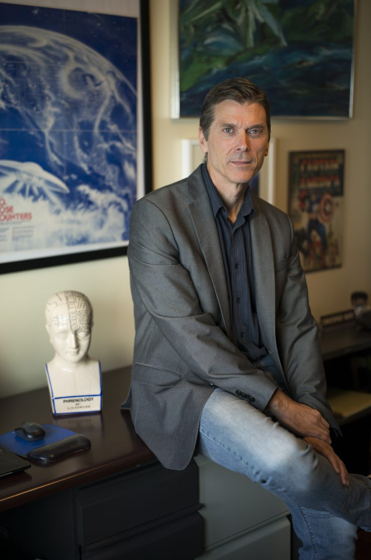 Professor Bader sits on his desk