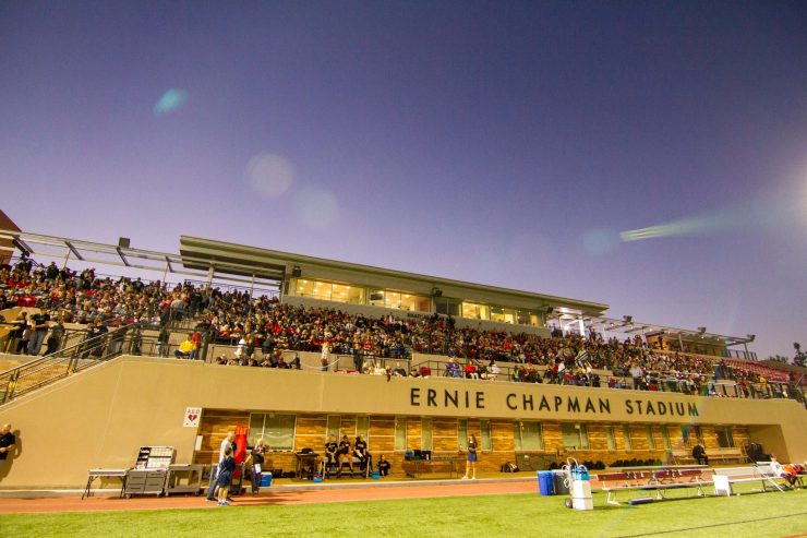 Twilight at Ernie Chapman Stadium with filled stands