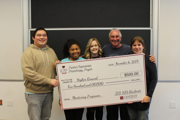 5 people and a giant check
