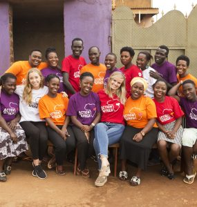 staff members in multicolored Action in Africa t-shirts