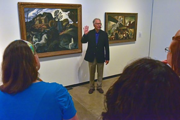 Mark Hilbert speaking to guests at the Hilbert Museum