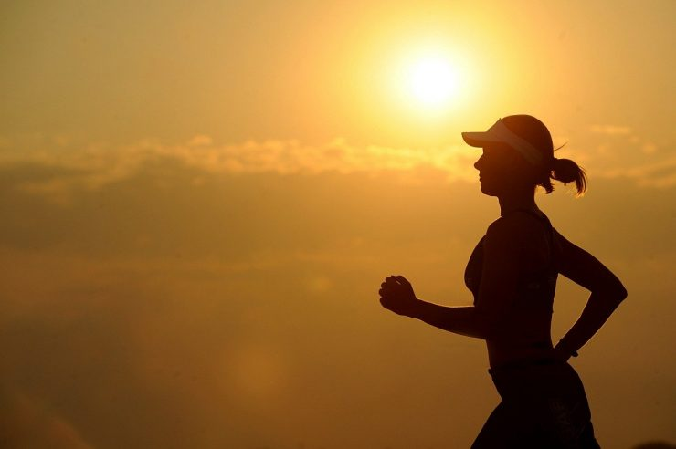 Woman running in the sunset