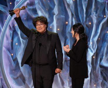 Bong Joon-ho holds up Oscar