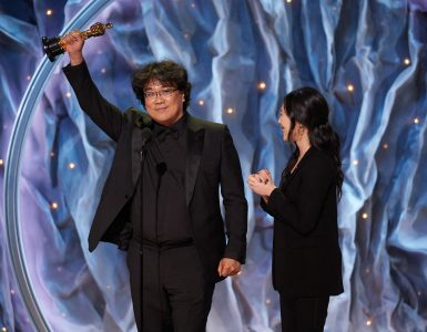 Bong Joon-ho holds up Oscar