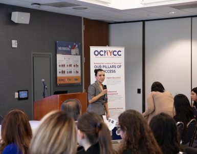 Panel moderator Gabriela Castañeda, assistant director of Chapman's Argyros School Career Services, welcomes attendees to the Women Empowerment panel discussion sponsored by the Orange County Hispanic Youth Chamber of Commerce. The event was hosted at Chapman.