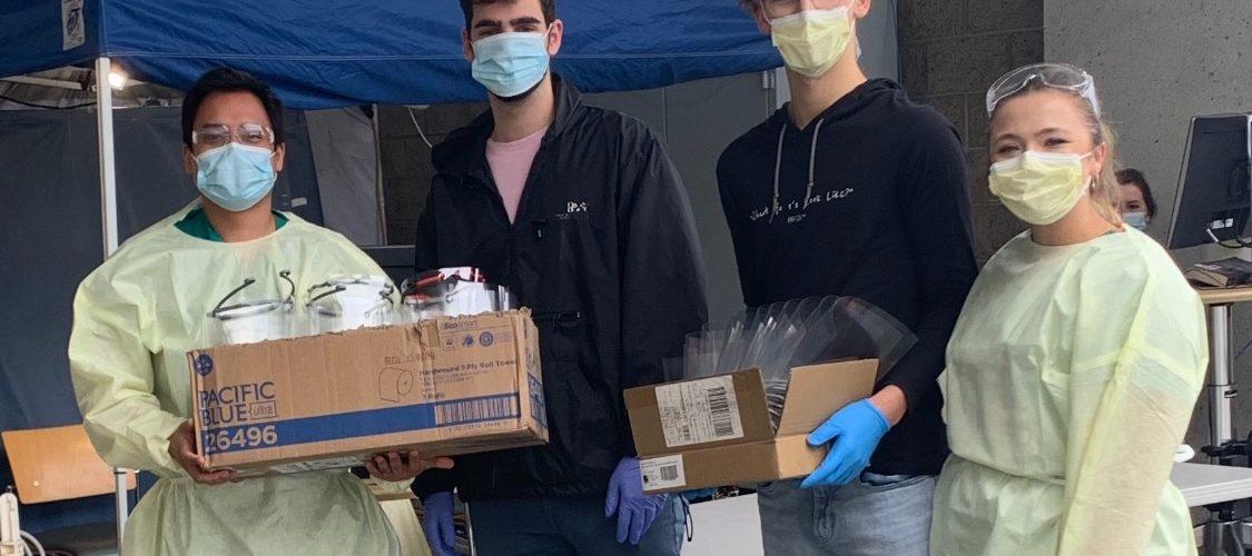 Alexandros (left) and Matt Drivas deliver face shields to St. John's Hospital
