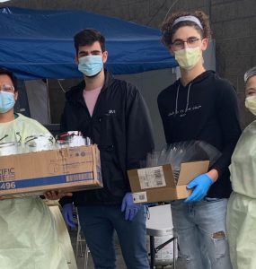 Alexandros (left) and Matt Drivas deliver face shields to St. John's Hospital