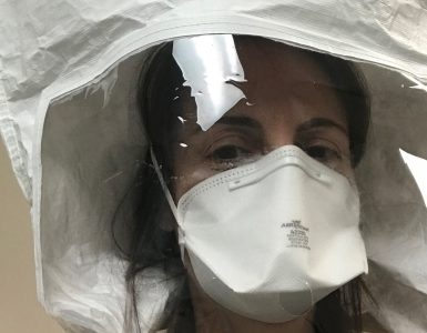 Physician assistant and Chapman professor Gabriela Belinsky during a fitting for the personal protective equipment she now uses when evaluating patients with potential COVID-19 symptoms at the medical clinic where she is helping out.