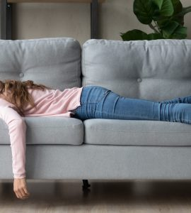 woman napping on couch