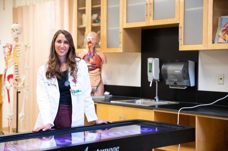 Woman in labcoat smiling