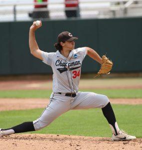 Man pitching baseball