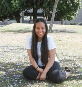 Adelin Tiburcio under a tree