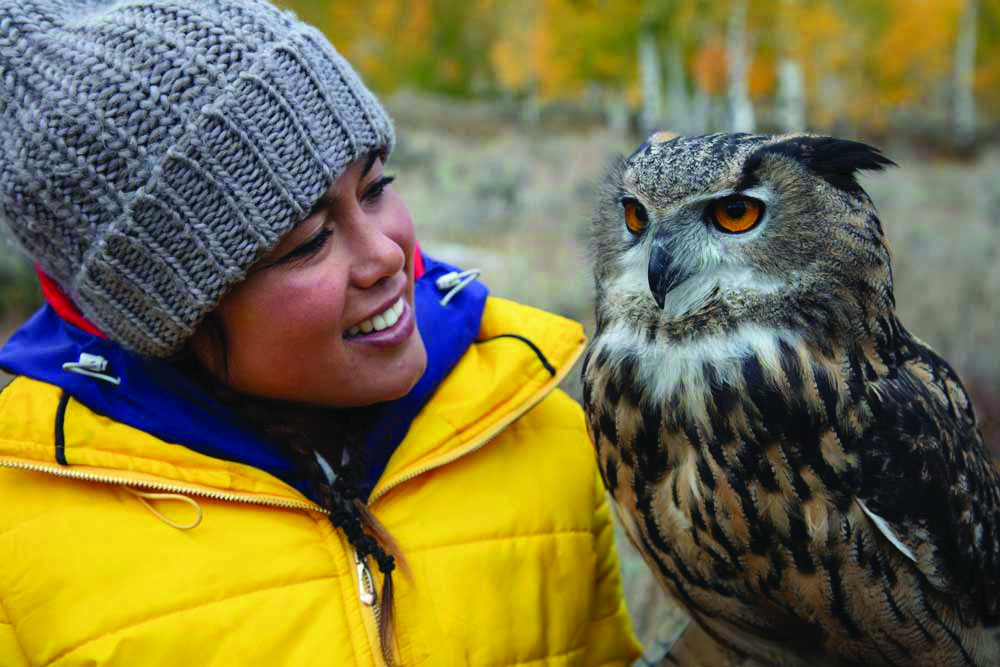 Ariel Tweto holds an owl.