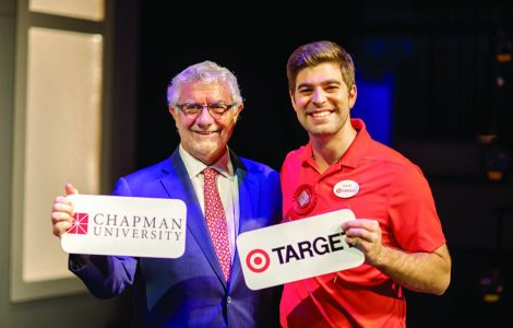 President Struppa poses next to a Chapman alumnus who is a Target corporate employee.