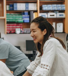 Bengjie Zhang, Ph.D., a postdoctoral research and teaching fellow at Chapman, works with a Grand Challenges Initiative student team on a pre-COVID-19 project.