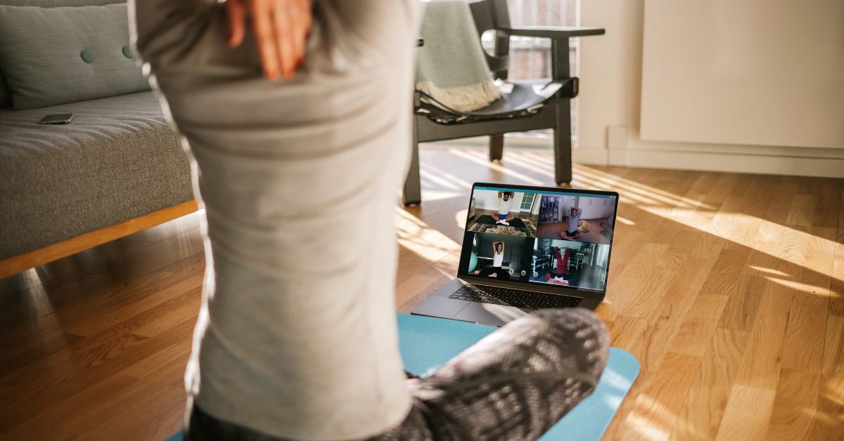 Fitness coach teaching yoga online to students