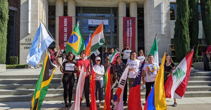 students holding flags of various countries.