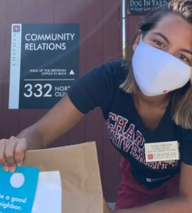 Alisa Dreyer '21 in front of Chapman University Community Relations office