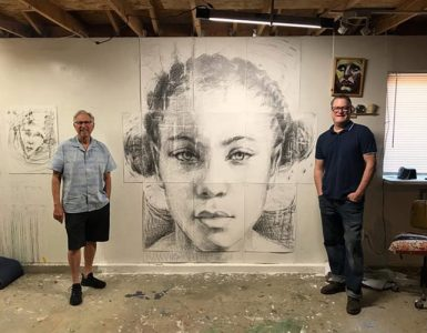 Artist and Hilbert founder pictured standing on opposite ends of large portrait of woman.