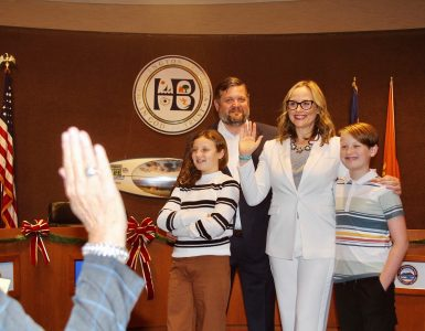 natalie moser and family in huntington beach council chamber