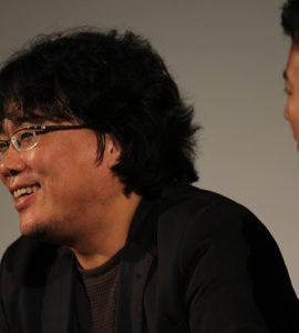 Image of Director Bong Jonn-Ho speaking at Chapman University's Busan International Film Festival in 2011.